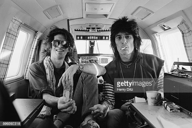 Rolling Stones guitarists Keith Richards and Ron Wood in a small plane