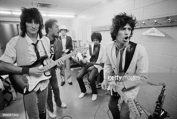 Rolling Stones guitarists Ron Wood Keith Richards and Stanley Clarke rehearse backstage before a concert