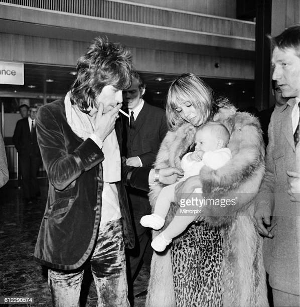 Rolling Stones Keith Richard at Heathrow Airport with Anita Pallenberg and their 4 months old baby Marlon 8th December 1969 two days after the band's...