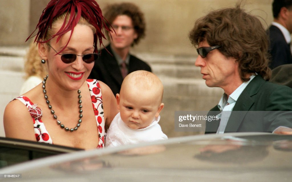 Rolling Stones lead singer Mick Jagger and model Jerry Hall with baby Gabriel attend the wedding of Princess Maria-Theodora 'Dora' Loewenstein to Manfredi Gherardesca, the younger brother of the Duchess of York's lover Count Gaddo della Ghereardesca, at the Brompton Oratory on September 27, 1998 in London.