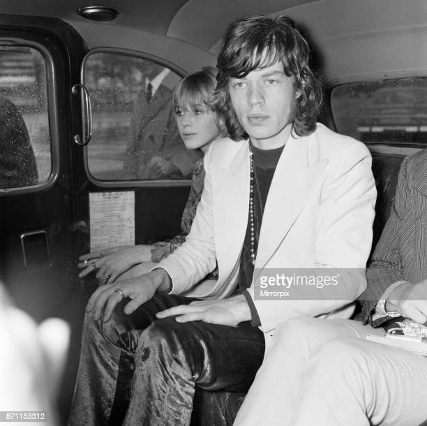 Rolling Stones lead singer Mick Jagger arrives at London Heathrow Airport with Marianne Faithful following their flight from Dublin where they went...