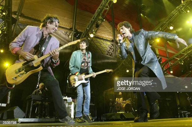 Rolling Stones lead singer Mick Jagger Ron Wood and Keith Richards perform in Foietes Stadium in Benidorm Alicante 25 September 2003 during the...