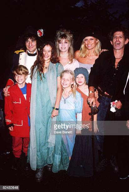 Rolling Stones musicians Ronnie Wood and Keith Richards with their families at Mick Jagger's 50th birthday party held on July 26 1993 in London