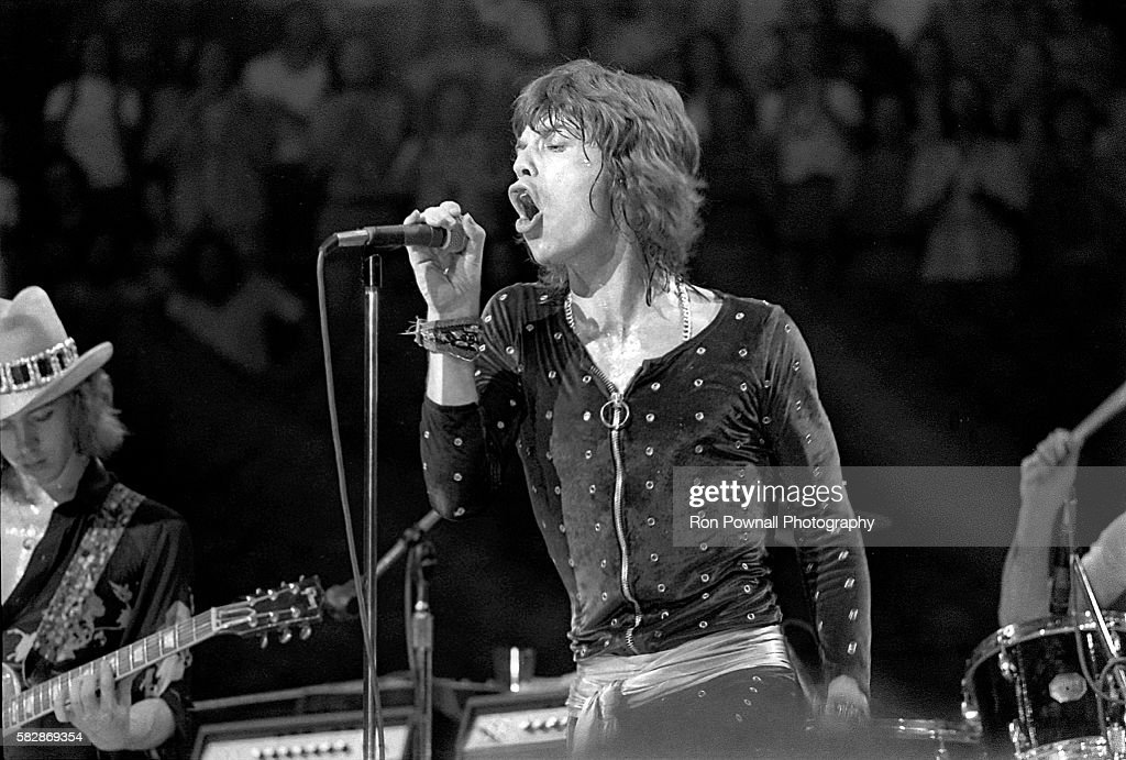 Rolling Stones performing at the Boston Garden, July 18, 1972. L-R) Mick Taylor, Mick Jagger, Charlie Watts' drumsticks.