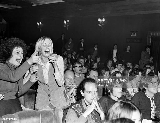 Two girls swinging in their seat at the Rolling Stones Pop Concert at the Seville Theatre tonight abbvious of Sir John Gielgud and Tony Richardson in...