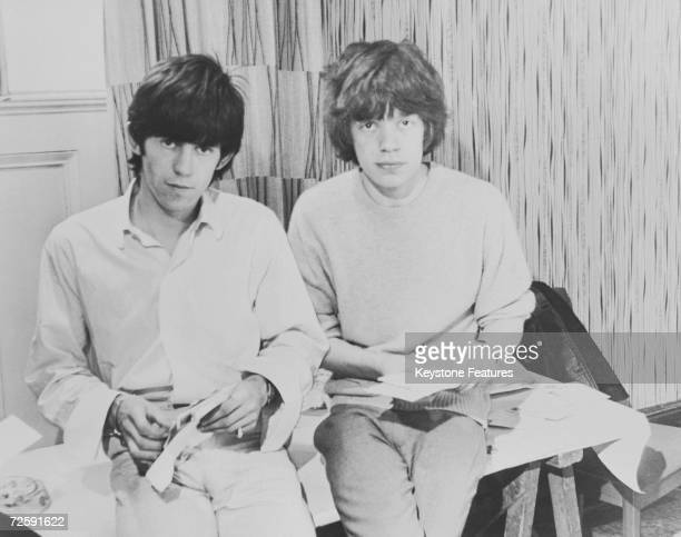 Rolling Stones singer Mick Jagger and guitarist Keith Richards opening fan mail during the early days of the band, circa 1963.