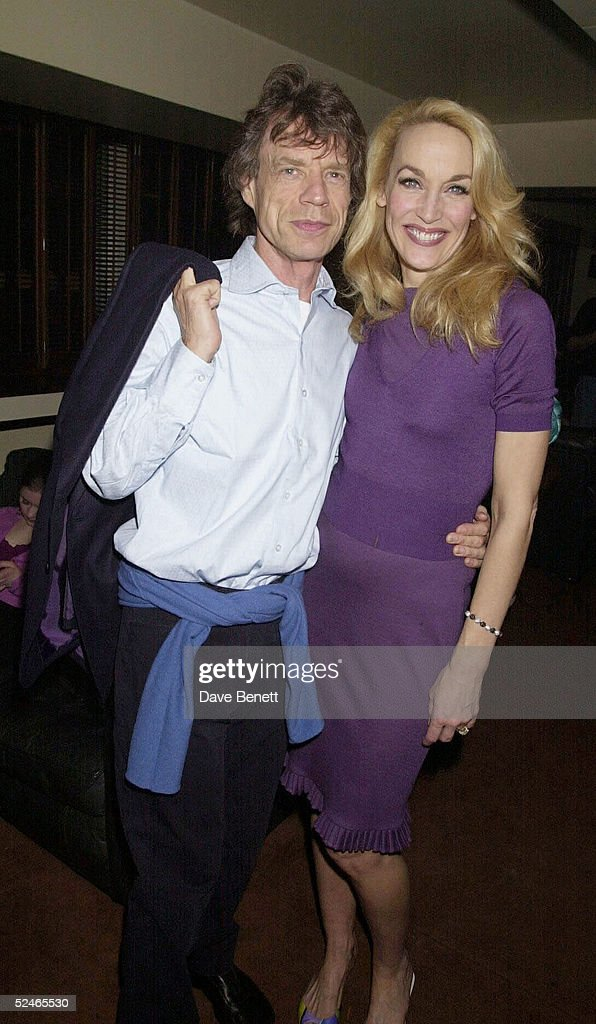 Rolling Stones singer Mick Jagger and his ex-wife model Jerry Hall at her farewell party after her last nigh in 'The Graduate' held at Teatro's on October 11, 2001 in London. (Photo by Dave Benett/Getty Images).