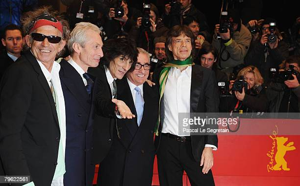 Rolling Stones singer Mick Jagger band members Ronnie Wood Charlie Watts and Keith Richards pose with Director Martin Scorsese at the 'Shine A Light'...
