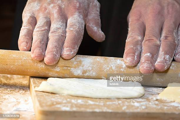 rolling up dough - lutavia stock pictures, royalty-free photos & images