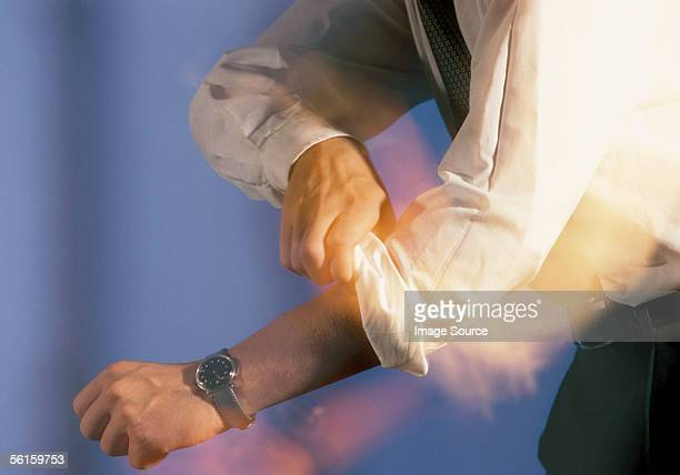 rolling up sleeves - rolled up sleeves stock pictures, royalty-free photos & images
