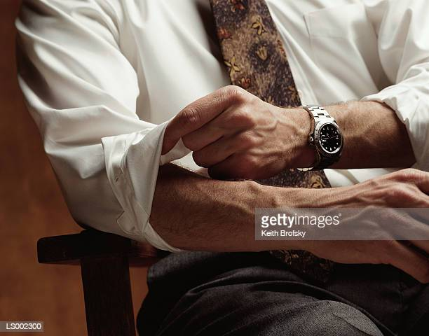 rolling up the sleeves - cuff sleeve stock pictures, royalty-free photos & images
