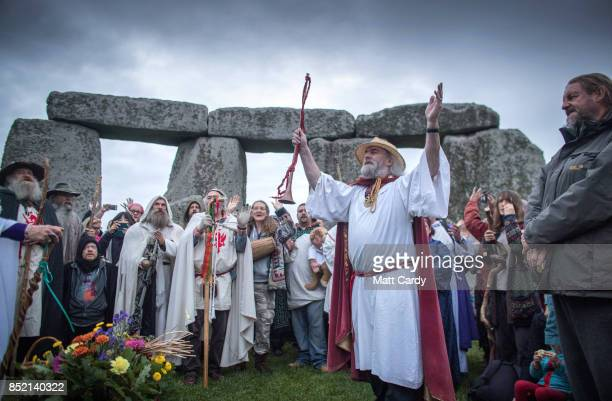 Rollo Maughfling Archdruid of Stonehenge and Britain conducts a ceremony as druids pagans and revellers gather in the centre at Stonehenge hoping to...