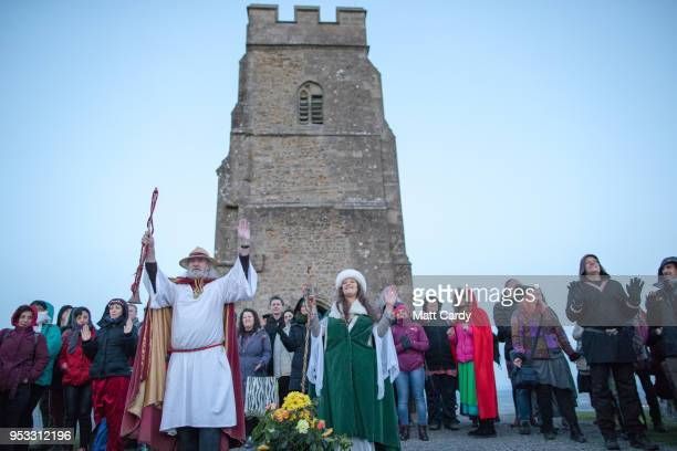 Rollo Maughfling the Archdruid of Glastonbury and Britain conducts a May Day dawn celebration service in front of St Michael's Tower as people gather...