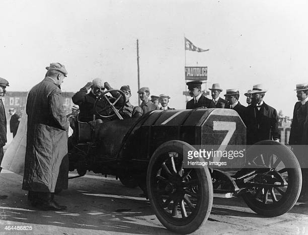 Rolls in a racing car, c1905-c1910. Rolls set up business selling French and Belgian cars before going into partnership with Henry Royce, forming the...
