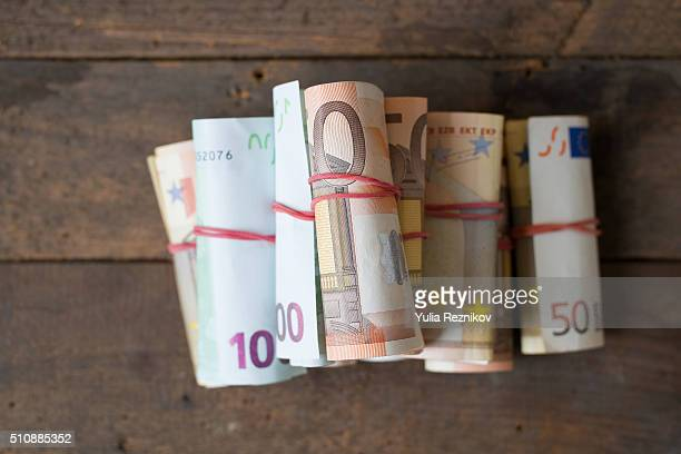 Rolls of 50 and 100 euro bills