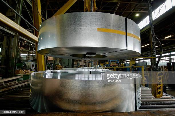 Rolls of coiled steel being processed at steel fabrication plant