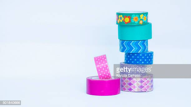 Rolls of decorative sticky tape for crafts on stacks