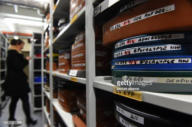 Rolls of film with the label 'Apocalypse Now' sit on shelves in a storage room at the Kino Arsenal cinema in BerlinGermany 22 January 2015 Photo...