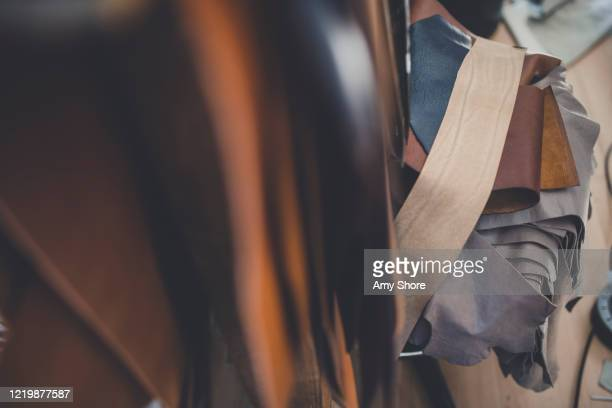 rolls of leather workshop - craft stock pictures, royalty-free photos & images