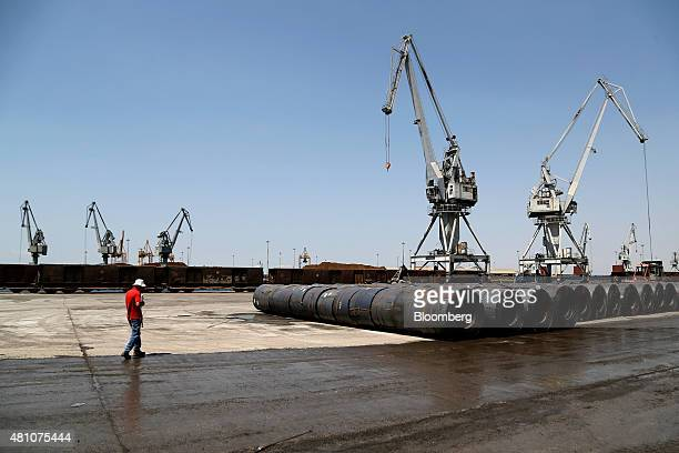 Rolls of metal sit on the dockside as shipping cranes stand beyond at Thessaloniki port operated by Thessaloniki Port Authority SA in Thessaloniki...