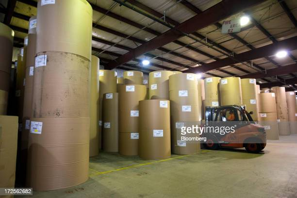 Rolls of new paperboard made from recycled cardboard wait to be moved to the warehouse at Newark Recycled Paperboard Solutions in Baltimore Ohio US...