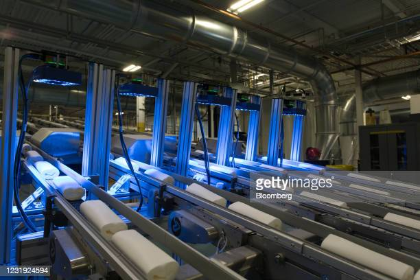Rolls of nonwoven fabric move along a conveyor belt during the production of Clorox Disinfecting Wipes at the company's manufacturing facility in...