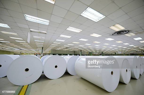 Rolls of paper stand at Asia Pacific Resources International Holdings Ltd's pulp and paper manufacturing facility in Pelalawan Riau Province...