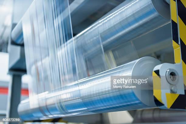 rolls of printed plastic film in food packaging printing factory - de rola imagens e fotografias de stock