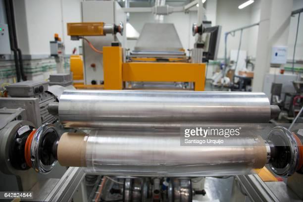 Rolls of printed plastic film in food packaging printing factory