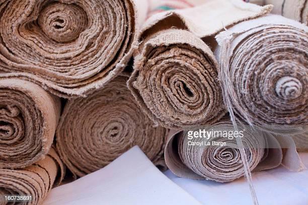 rolls of raw cloth