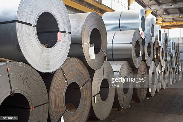 rolls of steel in warehouse - rolled up stock pictures, royalty-free photos & images