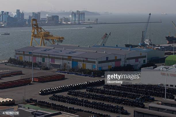 Rolls of steel manufactured by Posco bottom are stacked at the Port of Pyeongtaek in Pyeongtaek South Korea on Sunday March 2 2014 South Koreas...