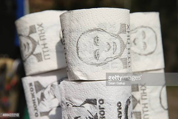 Rolls of toilet paper printed with a portrait of Russian President Vladimir Putin stand for sale at a vendor's stall on September 14 2014 in Lviv...