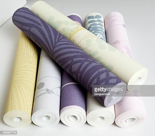 rolls of wallpaper - opgerold samenstelling stockfoto's en -beelden
