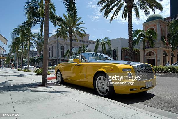 rolls royce on rodeo drive - rolls royce stock photos and pictures