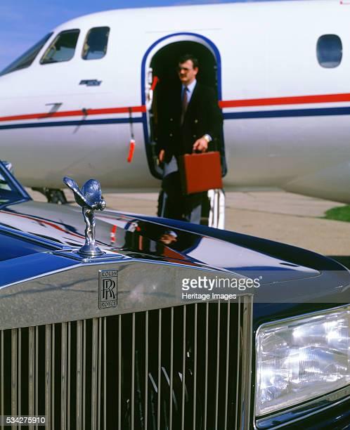 Rolls Royce Silver spirit awaits businessman disembarking private jet 2000