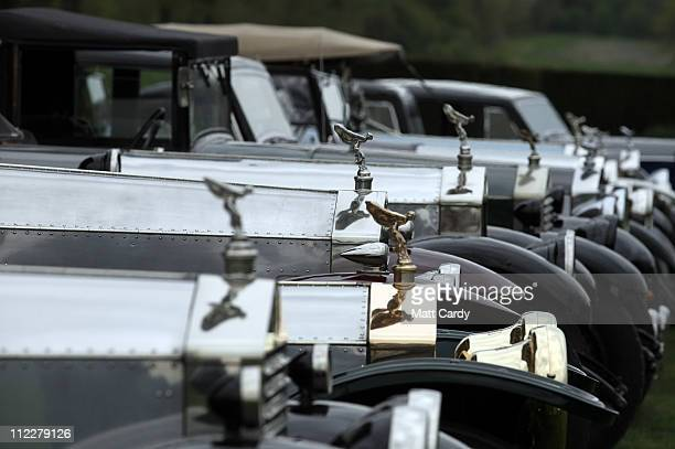 Rolls Royce Spirit of Ecstasy bonnet ornaments are seen on parked vintage cars in front of Northington Grange, the summer home of the Grange Park...