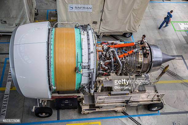 A Rolls Royce Trent 900 aircraft engine manufactured by Rolls Royce Holdings Plc sits on a transport platform on the Airbus A380 aircraft assembly...