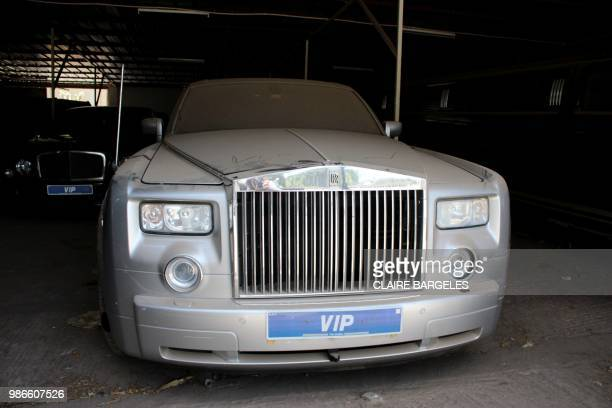Rolls Royce which belonged to former Gambian President Yahya Jammeh is parked covered in dust among other luxury cars at a garage in State House in...