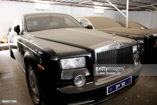 Rolls Royce which belonged to former Gambian President Yahya Jammeh sits parked covered in dust among other luxury cars at a garage in State House in...