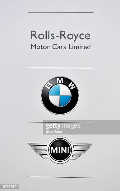 RollsRoyce BMW and Mini logos are seen during the Bayerische Motoren Werke AG news conference in Munich Germany on Wednesday March 17 2010 Bayerische...