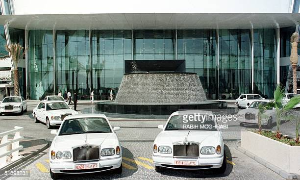 RollsRoyce cars are lined up at the entrance of Dubai's Burj AlArab hotel 11 November 1999 The world's tallest seabased hotel bought the RollsRoyces...
