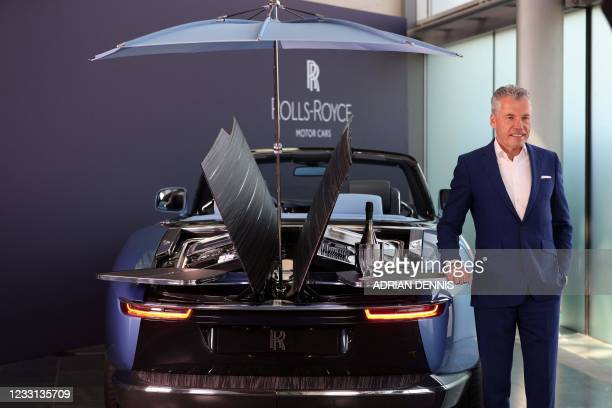 Rolls-Royce CEO Torsten Muller-Otvos speaks by a Rolls Royce Boat Tail on show at the company's Goodwood headquarters near Chichester, southwest...