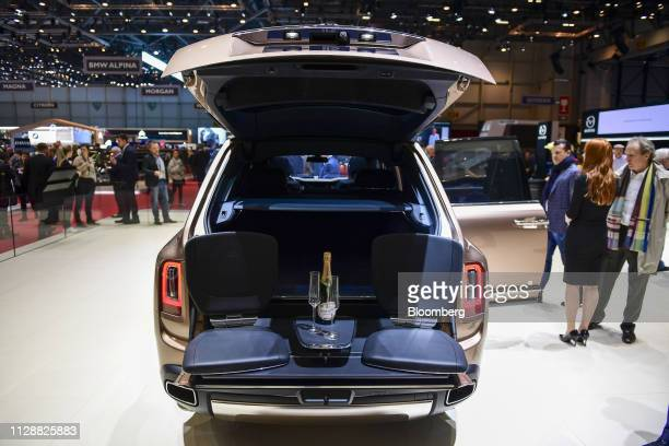 A RollsRoyce Cullinan sport utility vehicle sits on display on the RollsRoyce Motor Cars Ltd exhibition stand on day two of the 89th Geneva...