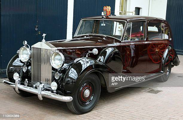 RollsRoyce state car is pictured at the Royal Mews in central London on March 21 2011 The car will be used by Prince Charles and Camilla the Duchess...