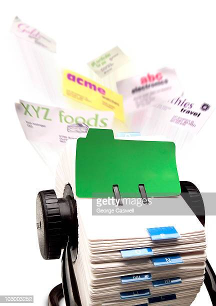 Rolodex with business cards flying out of it