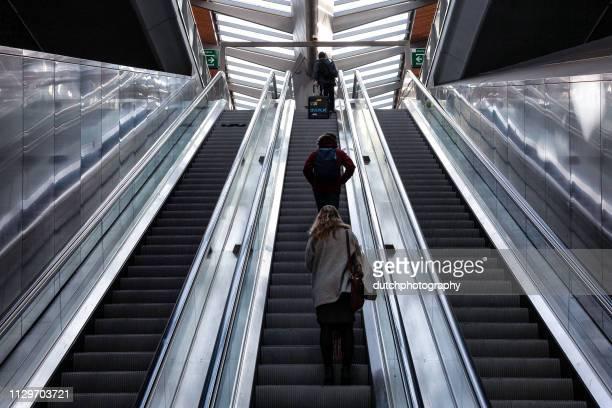 Roltrap met mensen station Amsterdam Bijlmer ArenA