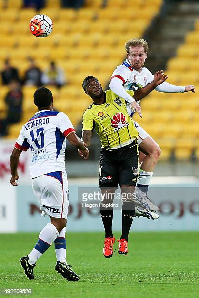 Roly Bonevacia of the Phoenix and David Carney of the Jets compete for a header during the round one ALeague match between the Wellington Phoenix and...