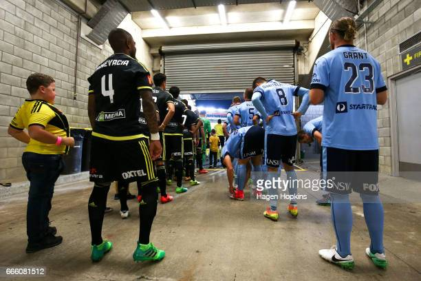 Roly Bonevacia of the Phoenix and Rhyan Grant of Sydney FC prepare to take the field during the round 26 ALeague match between the Wellington Phoenix...