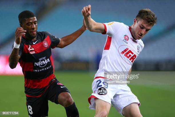 Roly Bonevacia of the Wanderers and Ryan Strain of Adelaide compete for the ball during the round 15 ALeague match between the Western Sydney...